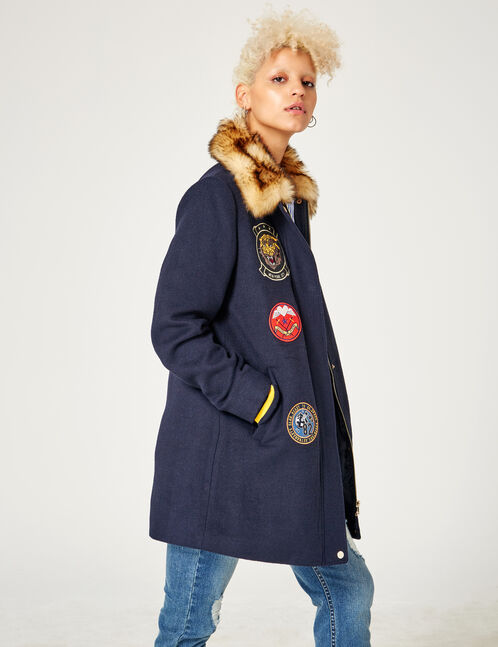 Navy blue coat with assorted patches