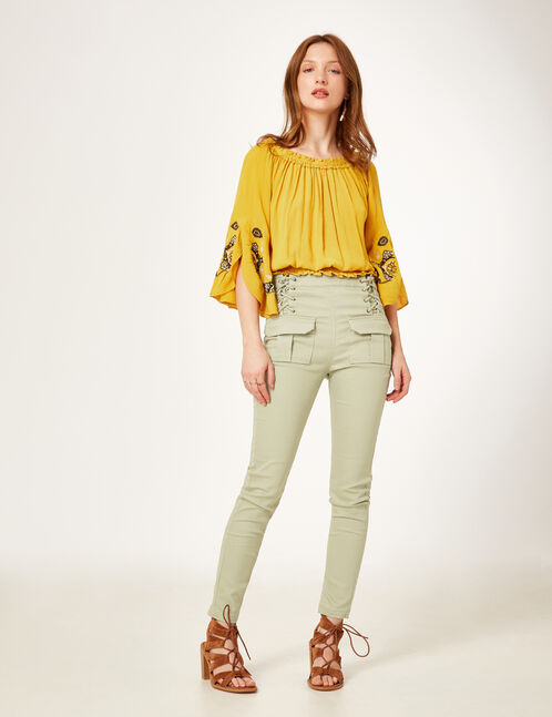 Light khaki trousers with lacing detail