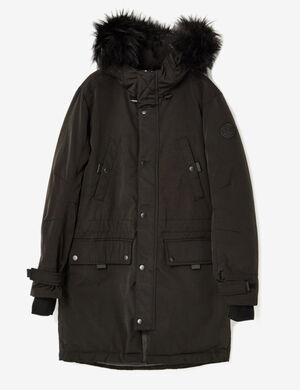 Product Parka longue femme, noir, capuche avec fausse fourrure amovible, 4 poches, fermeture zippée avec boutons pressions, manches longues finitions bords côtes.Marque Jennyfer Catégorie vestes + manteaux