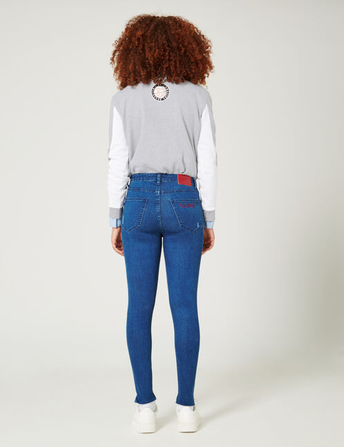 Medium blue jeans with embroidered text design detail