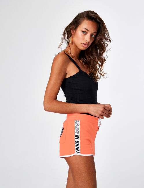 Coral jersey shorts with text design detail