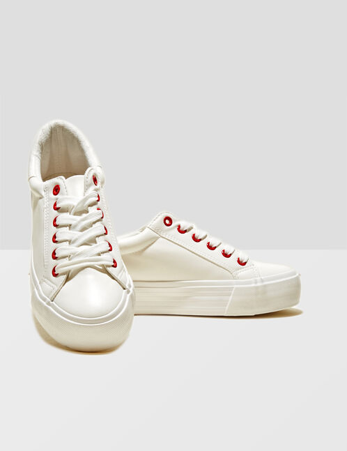 White trainers with text design detail