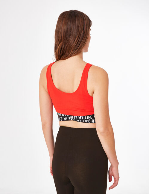 Red sports bra with text design detail