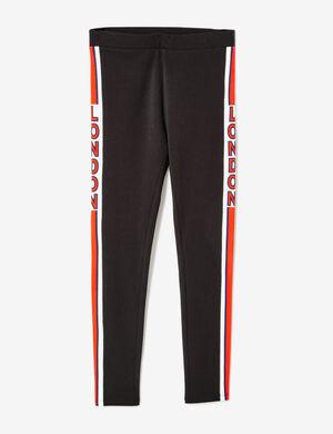 Product Legging femme, noir, message london sur les côtés, rayures rouges et bleu marine, taille élastiquée.Marque Jennyfer Catégorie joggness