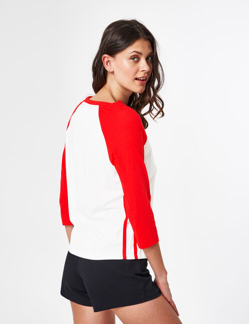 Cream and red top with cut-out detail