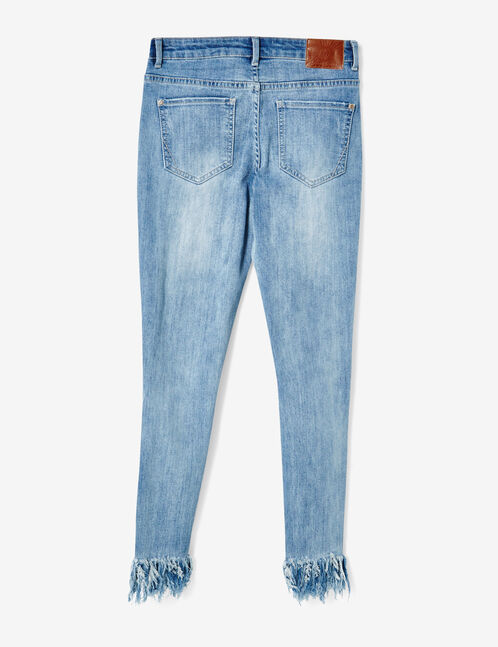 Medium blue distressed jeans with frayed hems