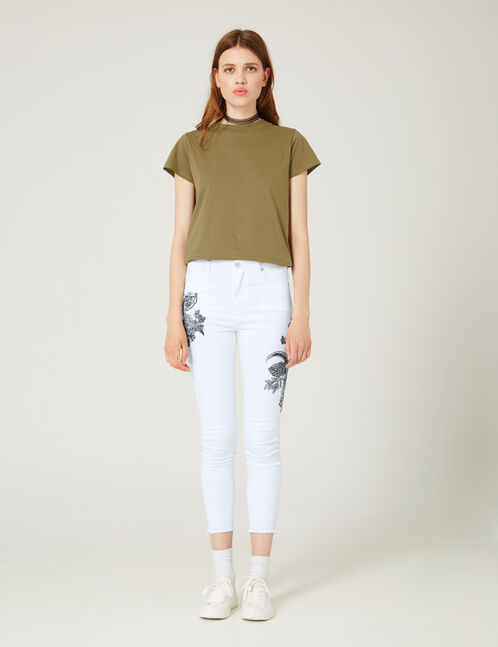 Cream trousers with embroidered detail