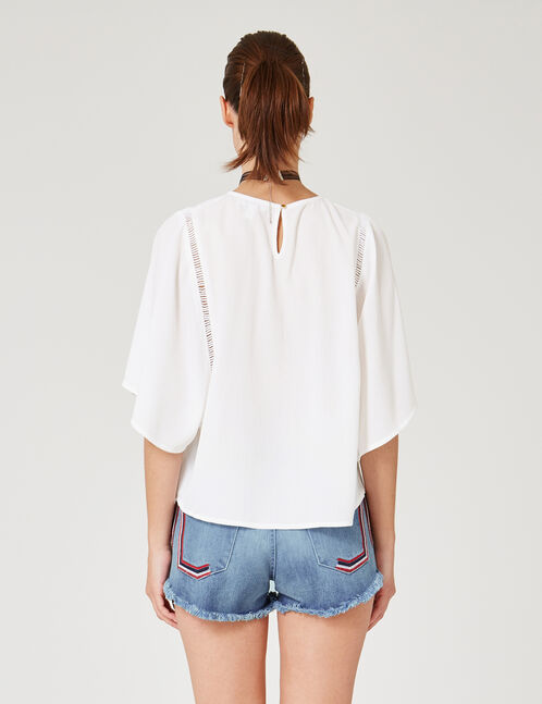 White flared blouse with macramé detail