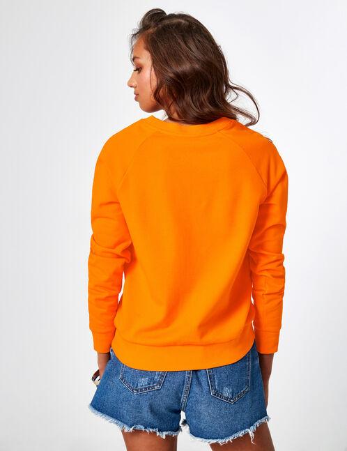 Orange sweatshirt with text design detail