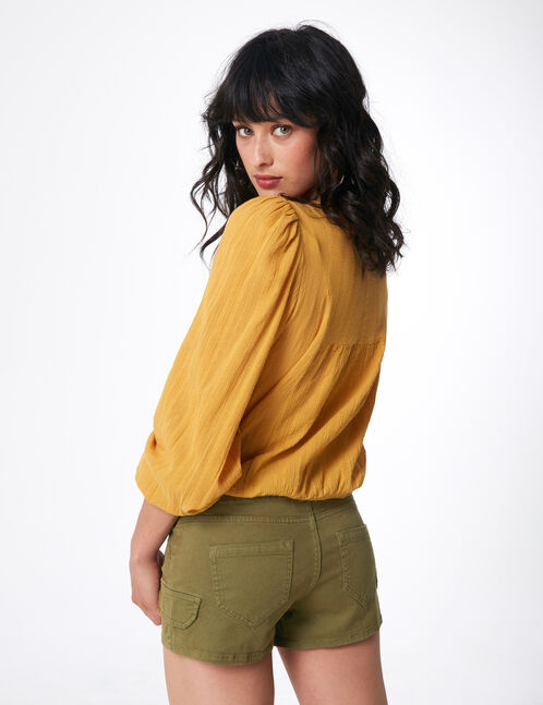 Khaki cargo-style shorts