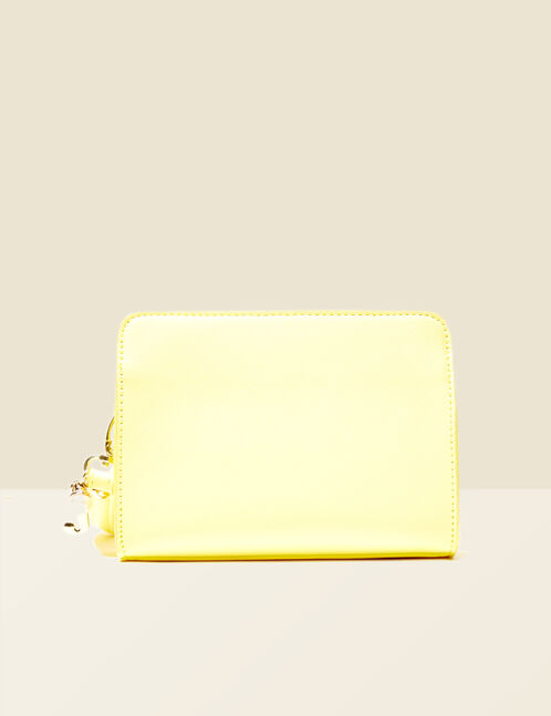 Small pale yellow textured bag with charm detail