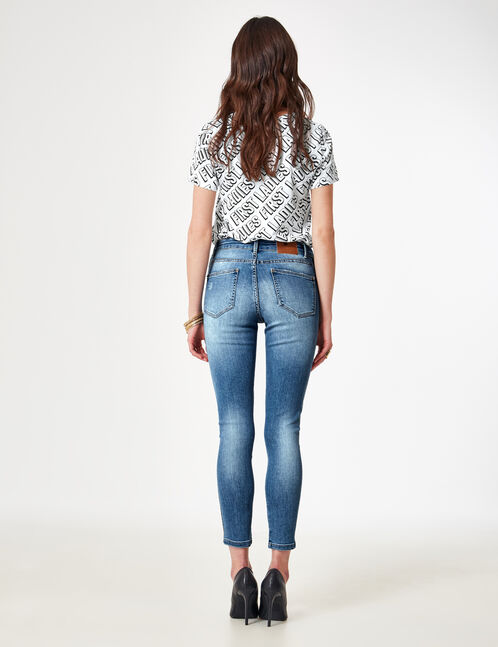 Medium blue jeans with side strap detail