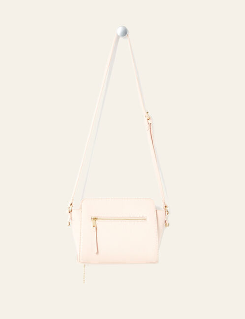 Light pink crossbody bag with charm detail