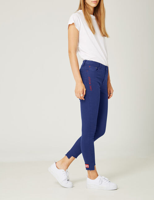 Navy blue trousers with embroidered detail