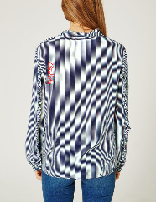 Navy blue and white striped blouse with text design detail