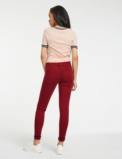 Burgundy distressed skinny trousers