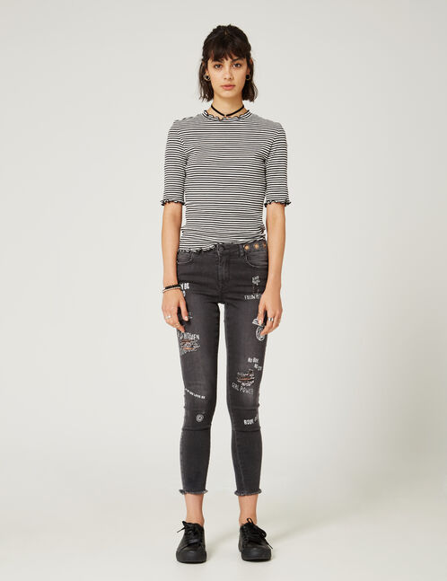 Black distressed jeans with mixed prints