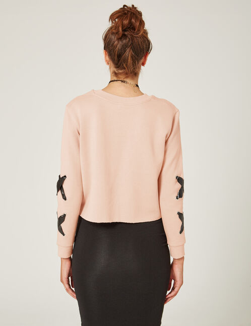 Light pink sweatshirt with lacing detail