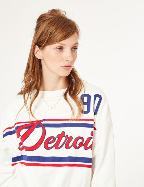 Cream sweatshirt with text design detail