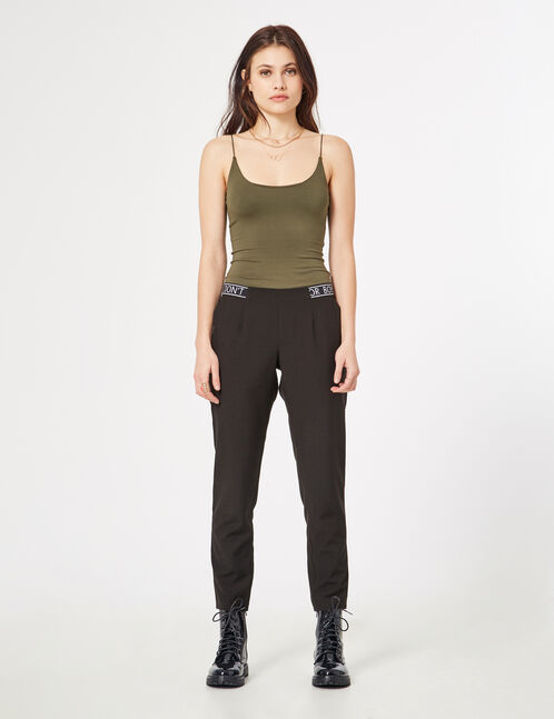 Black straight-leg trousers with text design detail
