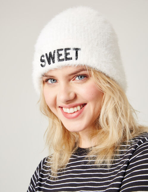 Cream beanie with text design detail