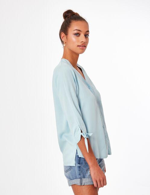 Light blue V-neck shirt