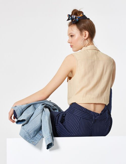 Beige sleeveless shirt
