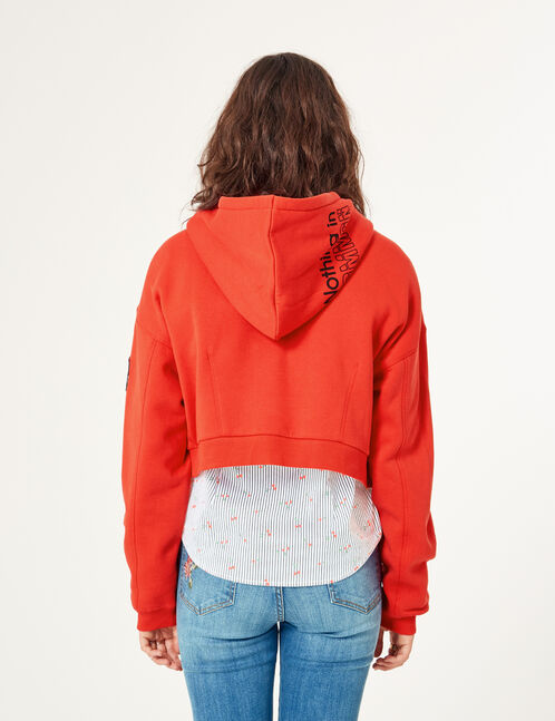 Red cropped hoodie with text design detail
