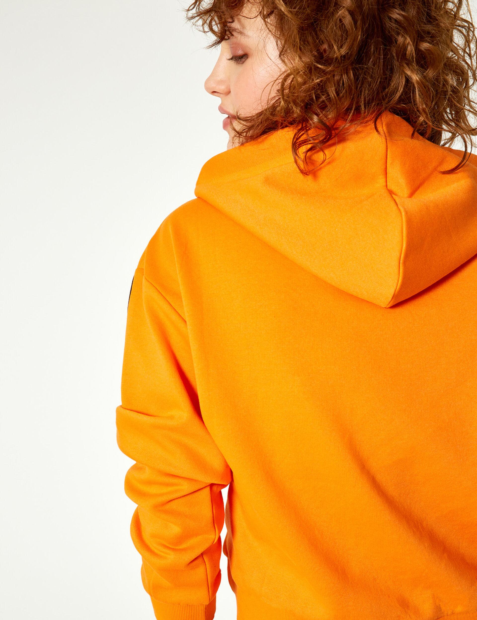 Orange and white hoodie with chevron detail