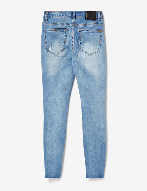 Light blue skinny jeans with stud detail