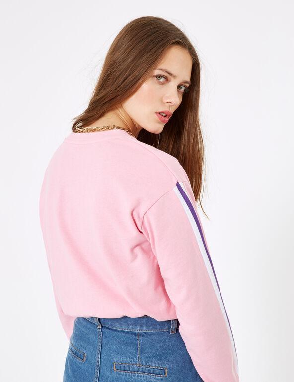 Pink sweatshirt with text design detail