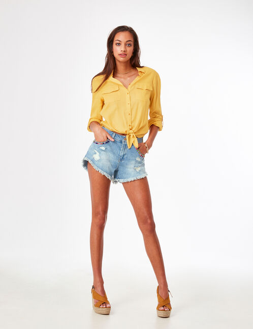 Light blue denim shorts with tassel detail