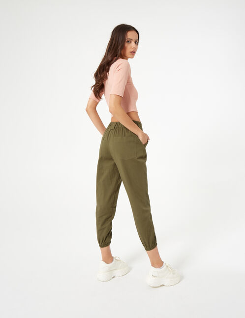 Khaki trousers with chain detail