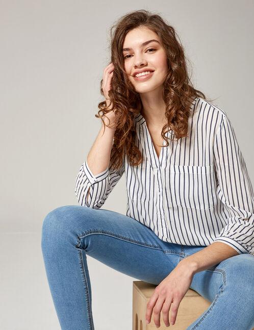 White and navy blue striped V-neck shirt