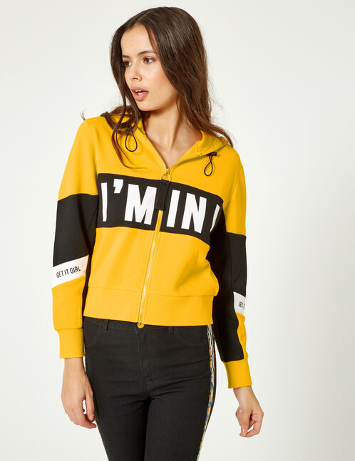 Yellow, black and white zip-up hoodie with text design detail