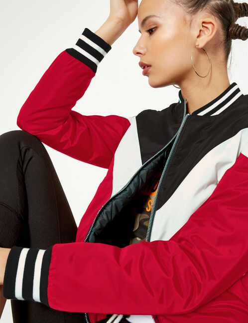 Black, red and white bomber jacket with chevron detail