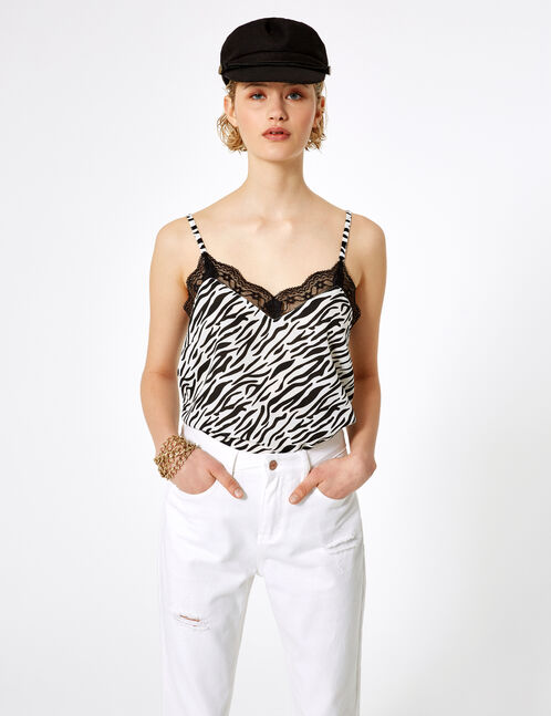 Black and white zebra print blouse with lace detail