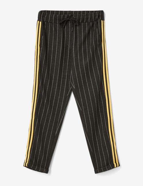 pantalon avec bandes rayées noir et blanc