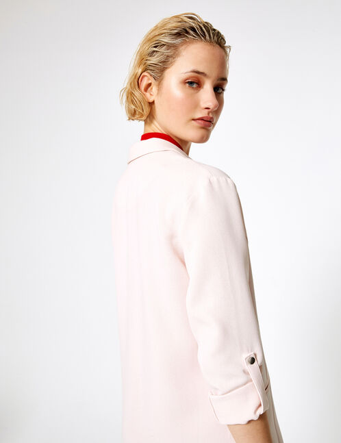 Light pink blazer with roll-up sleeves