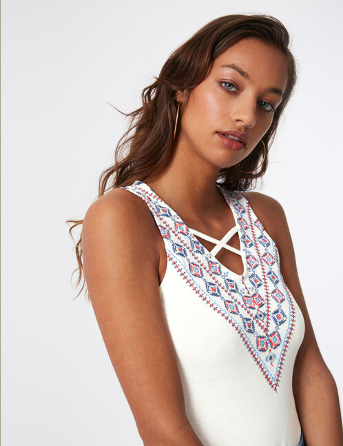 White bodysuit with embroidered detail