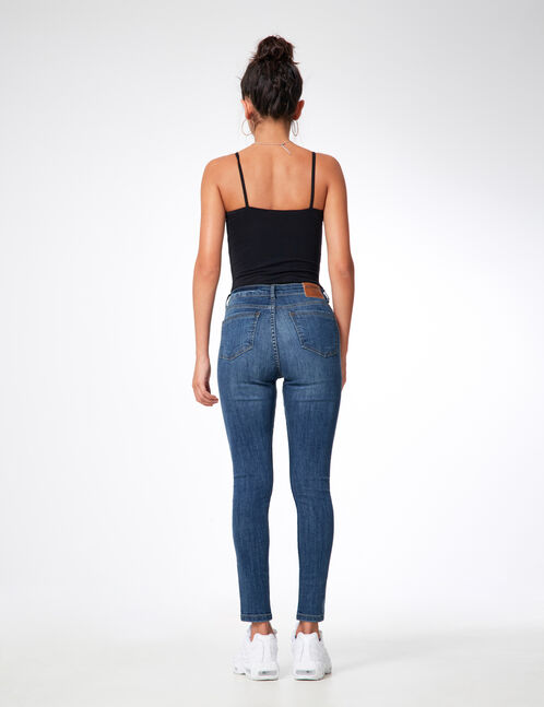 Medium blue zipped jeans with stripe detail