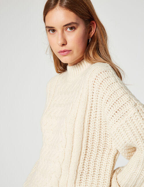 High-neck cable-knit jumper