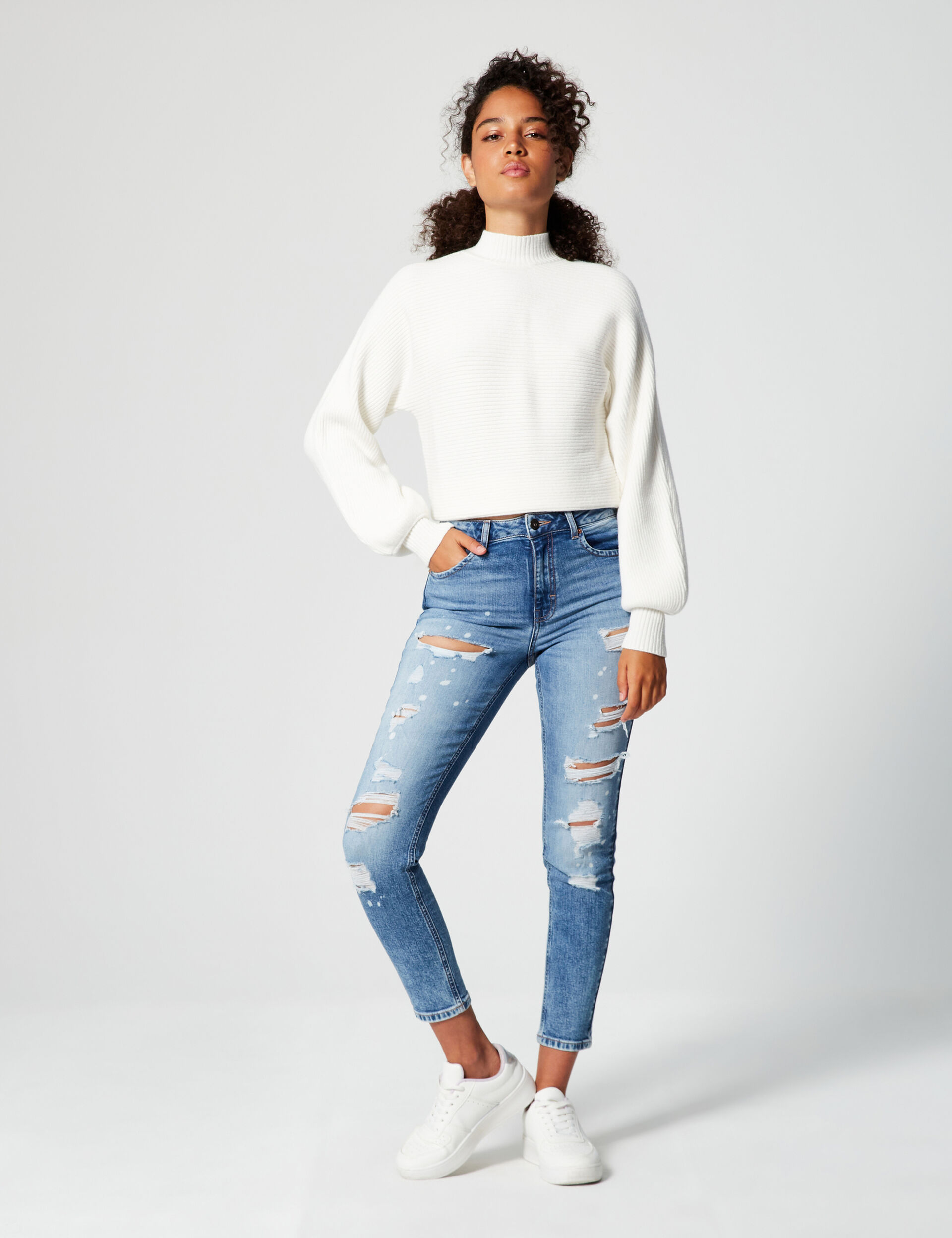 High-waisted distressed skinny jeans