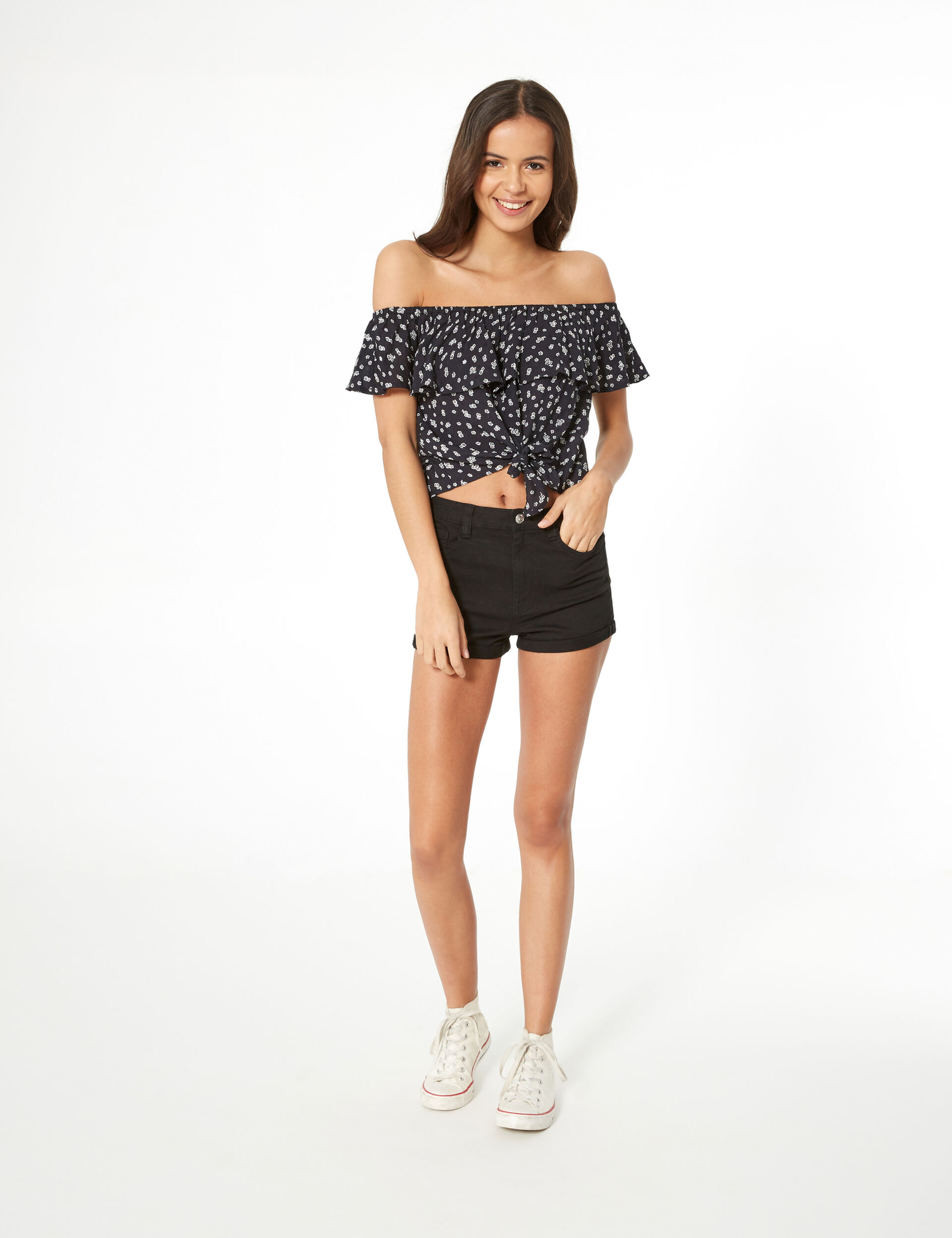 Black and white floral blouse with frill detail
