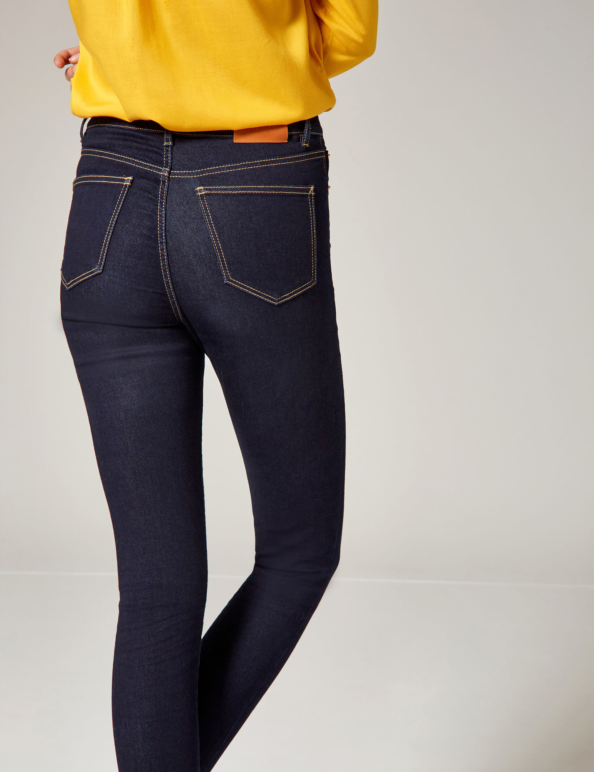 Raw denim high-waisted skinny jeans