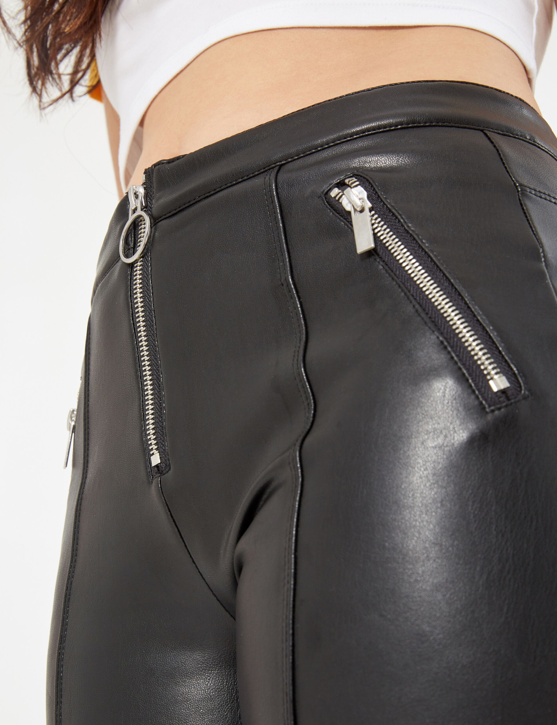 Faux leather trousers with zip detail