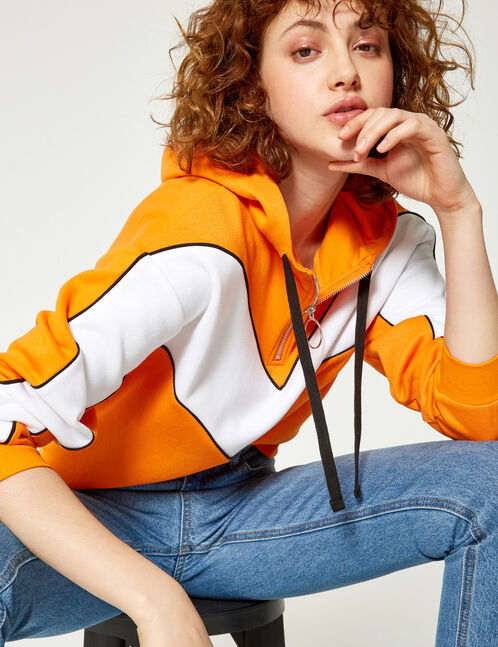Orange and white hoodie with chevron detail