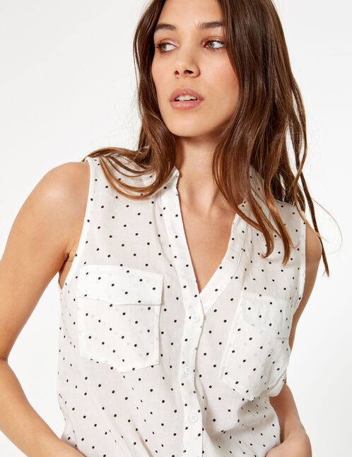 White and black sleeveless polka dot blouse