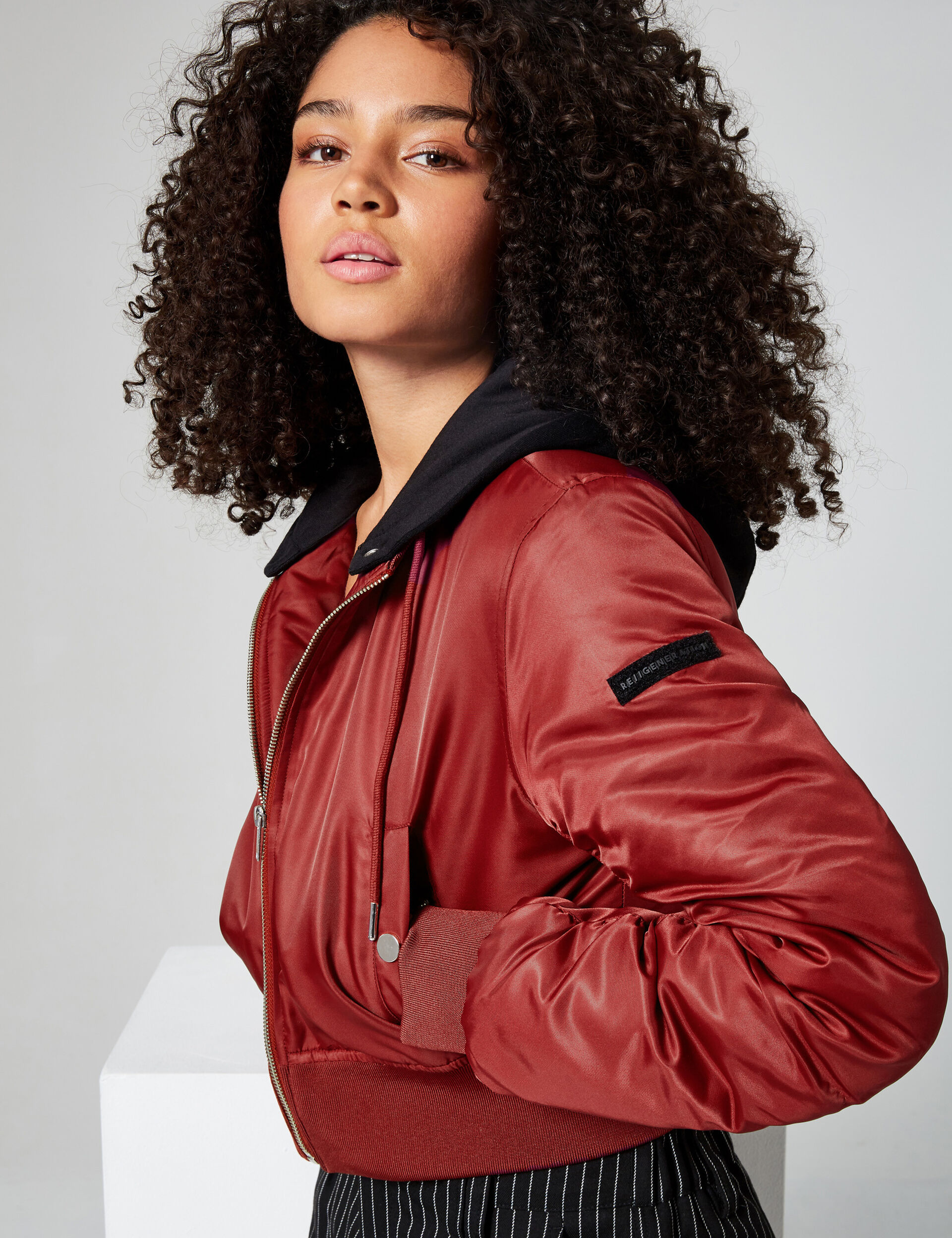 Bomber jacket with knitted hood
