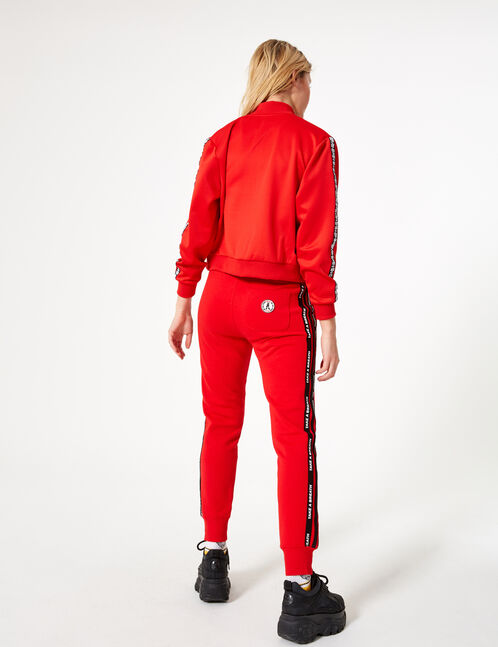 Red joggers with stripe detail